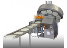 Machine à plaques inclinées pour crepes brick rukak - Machine automatique pour la cuisson sur 1 ou 2 côtés de produits très fins à fins. Ces machines peuvent être complétées par de l'empilage avec comptage, du dosage de farce précis en poids et en positionnement, du pliage, du roulage.